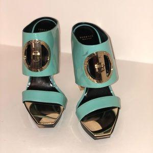 Brand new Versace blue heels. Very comfortable